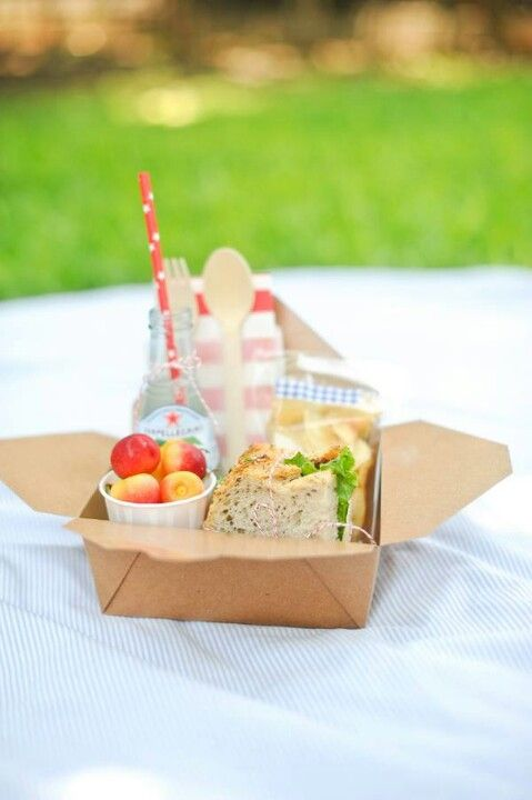 Picnic in a box with a red straw.