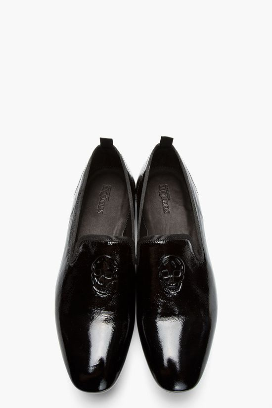 ALEXANDER MCQUEEN Black patent logo-embossed loafers