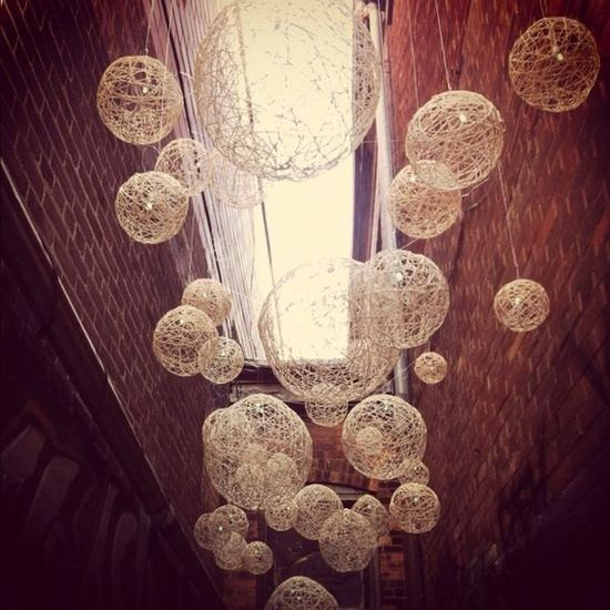 Wouldn't these handmade string lanterns make a beautiful subtle statement as reception or rehearsal dinner decor?