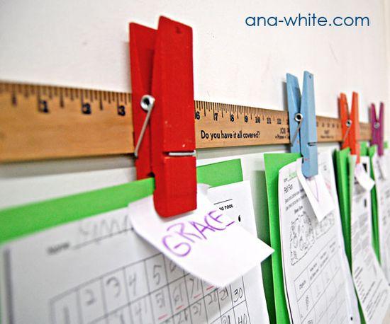 clothespins + yard stick = art hanger