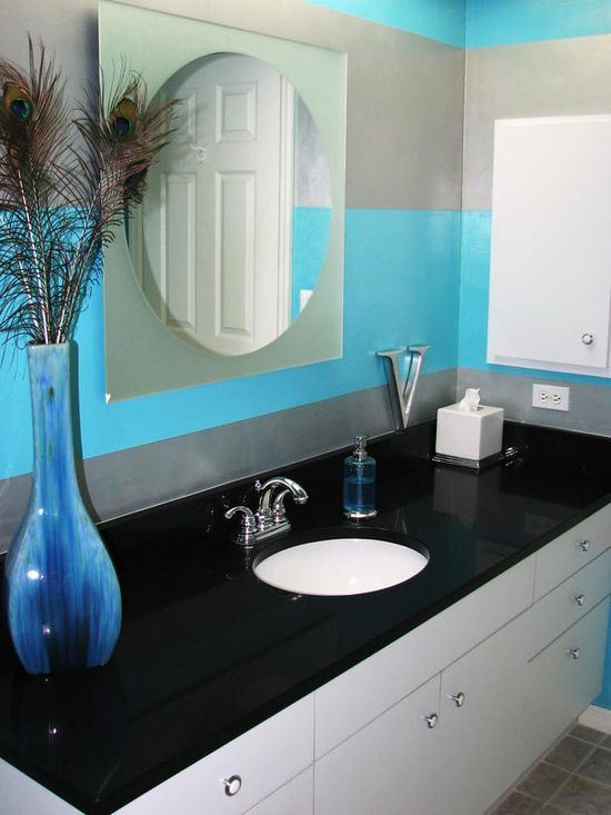 Turquoise and metallic stripes make this bathroom stand out.