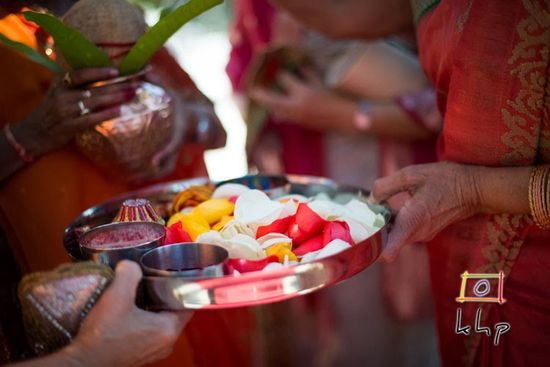 Colorful rose petals at a traditional Indian wedding