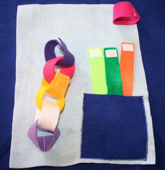 Easy to make activity for Judah:  cut some strips of felt, iron on velcro pieces, and see what he can create!