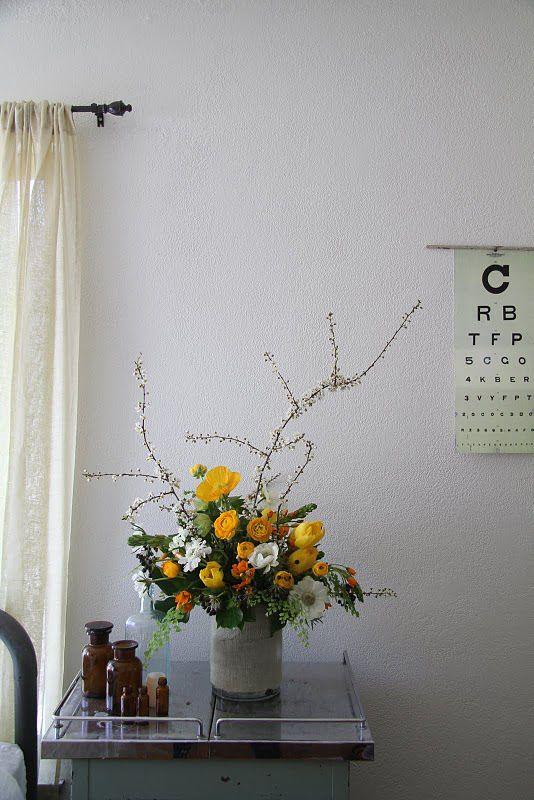 honey of a thousand flowers. adore her flower arrangements.