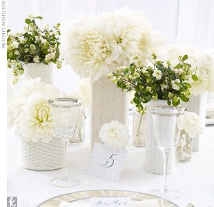 I love the multiple bunches of flowers and the white look, especially for a white tent wedding.