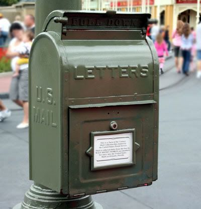 Mailing postcards from Disney Worlds Main street. Letters are stamped 'From Disney World'