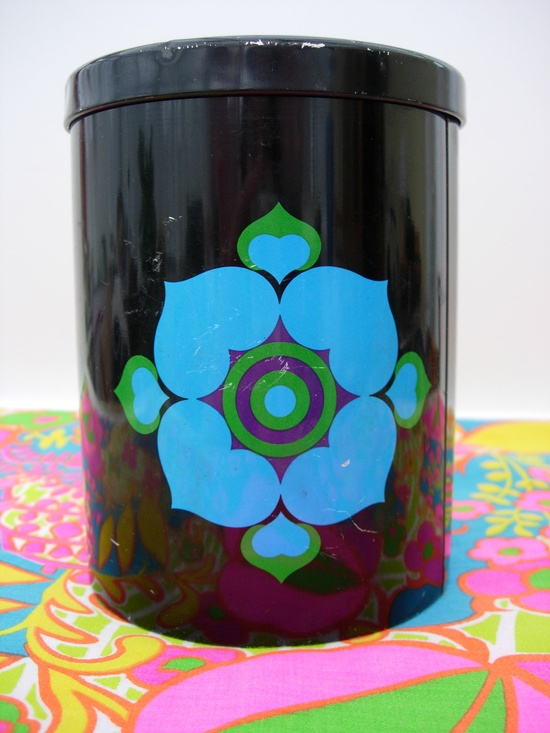 Retro 60s or 70s Mod Tea Caddy Storage Tin Black and Turquoise Fab Design. £14.99, via Etsy.