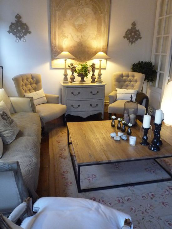Small but intimate living room...love the soft colors and wall decor