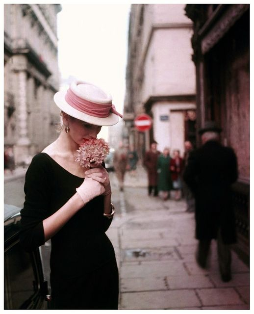 Suzy Parker pauses for a moment of quiet thought on the streets of Paris, 1953. #vintage #fashion #dress #1950s #hat