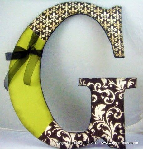 wooden letter, mod podge, scrapbook paper, and ribbon