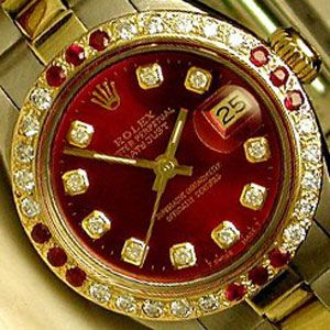 Ladies Rolex Red Ruby & Diamond  The Ladies Red Ruby & Diamond Rolex watch features a beautiful deep ruby red diamond dial with a diamond and ruby bezel.