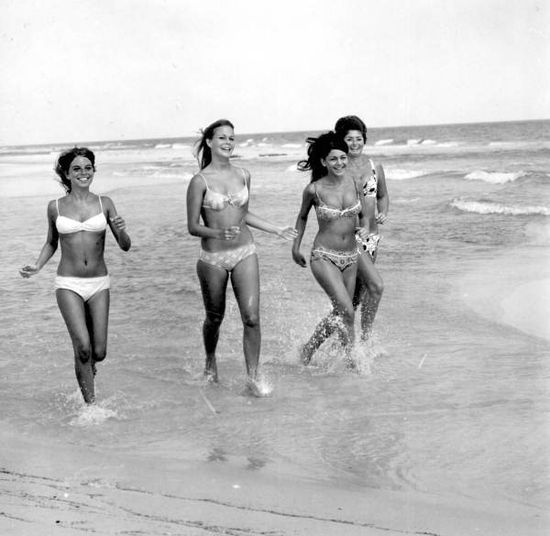1960s bikini models running on the beach