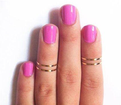 Midi rings, Pink nails.