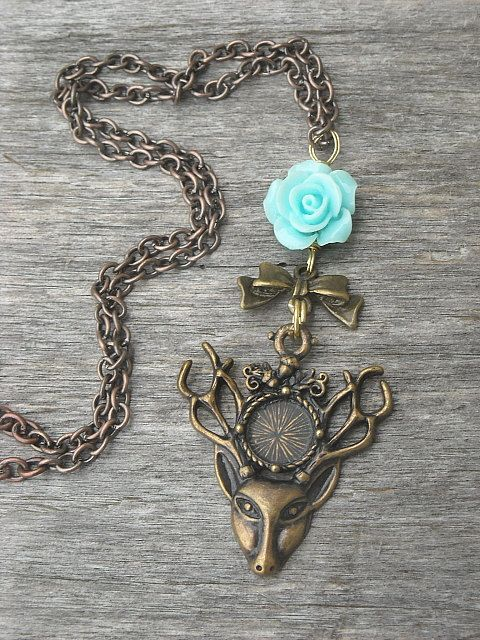 Deer Head Necklace with Blue Rose and Bow by InkandRoses13