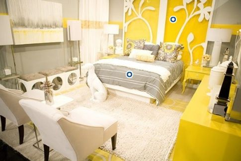 Love gray and yellow in this bedroom! Gray white yellow bedroom colors! Gray paint wall color! yellow gray white bedroom colors. unique custom made flower gray yellow headboard panels, white cream upholstered chairs, white column table lamps, modern chrome floor lamps and bright yellow dresser!