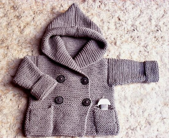 Baby sweater with hood.