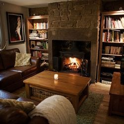 A Decor DIY before and after renovating a cosy brick cottage living room with real fire and wood