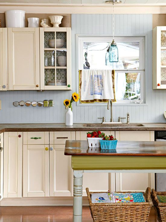 Mismatched cabinet knobs and pulls add personality to this kitchen. Tour the rest of this home: www.bhg.com/...