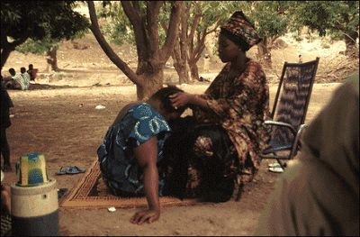 Braiding hair in Mali Africa