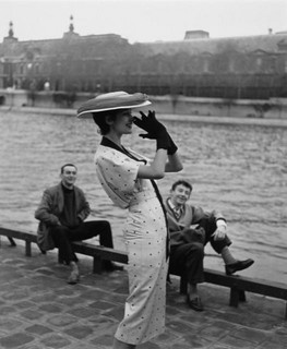 A playful pose to match her charming polka dot dress. #vintage #fashion #1950s #hat