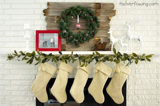 christmas mantel; i like the wood behind the wreath