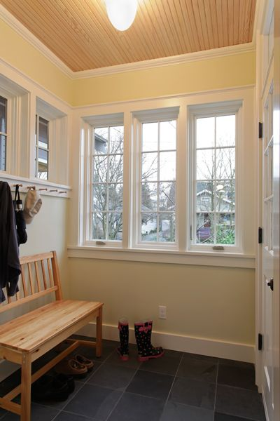 Tim Andersen, Architect.  Greenlake, Seattle. Inside mudroom entry there are Shaker pegs for coats and a black slate floor for wet shoes and bikes.