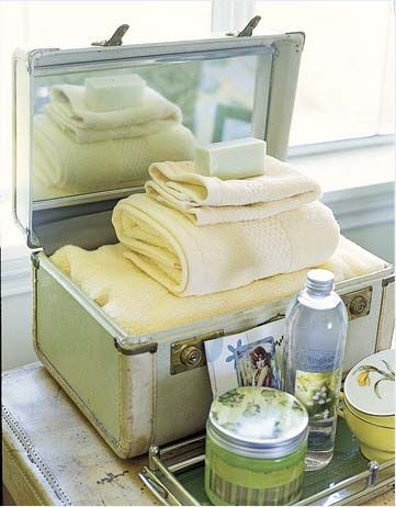 An old suitcase makes a perfect guest bathroom accessory.
