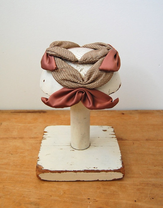 This is a ridiculous marvel of a hat. 1950s. I can't really picture what this would look like on a real woman, but I love it.