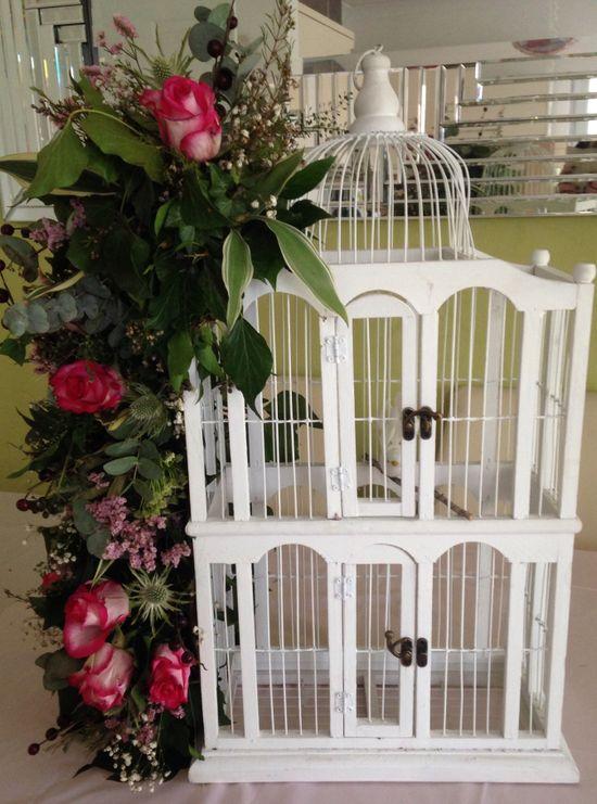 Boho birdcage flower arrangement