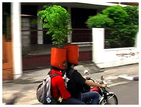 """Treebute to Yogya, by Sara Nuytemans and Arya Pandjalu, took the form of a performance in which a bike gang drove through the city of Yogyakarta wearing helmets filled with soil and planted with a tree."""