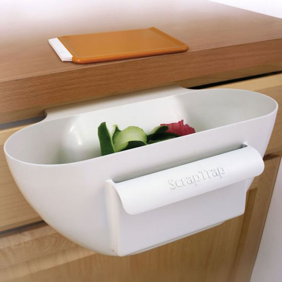 Scrap Trap Bin and Scraper--Slips over your drawer to keep counters and sinks clear while your prepare food. pretty cool
