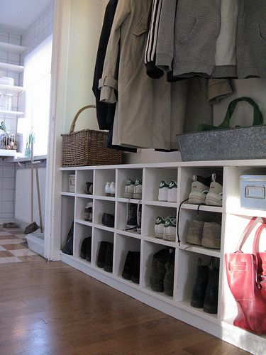 Mud room: bottom shelf for boots, then shoes, then hooks for coats, umbrella, backpacks & purses, then top shelf for hats and gloves-baskets