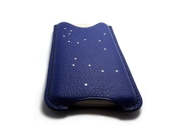 A cosmic iPhone 5 case scattered with stars.