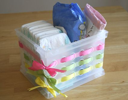 """If you don't have the money for expensive crafting materials, this idea is beyond adorable: buy a cheap plastic container with holes, and simply thread odd bits of ribbon though! Cheap but very effective. cute way to gift a gift and even the """"gift bag"""" is useable!"""