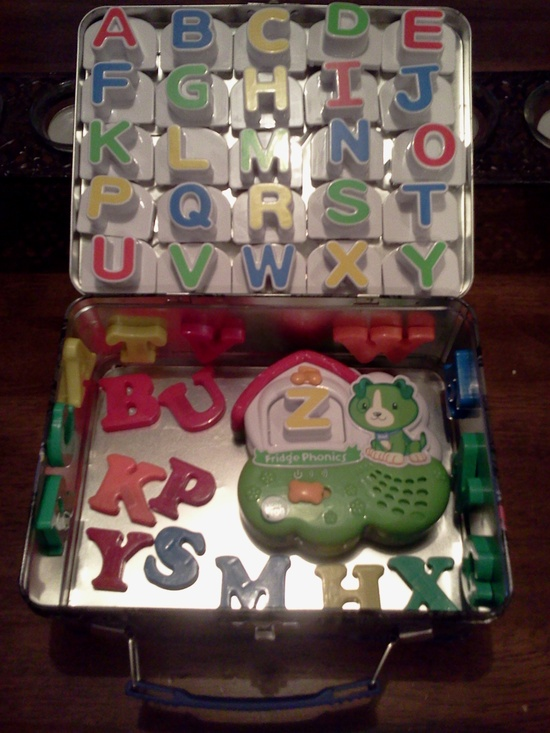 Store magnetic letters in a metal lunch box. Great car activity or keeping kids busy anywhere! Love this since L loves his letters and play with them everywhere. :) Now that its complete I'm ready for our next road trip. Luke's lunchbox was from Old Navy and not as large as this one. I had to place all the Leapfrog magnets on the sides and everything. No room for extra letters like this one.