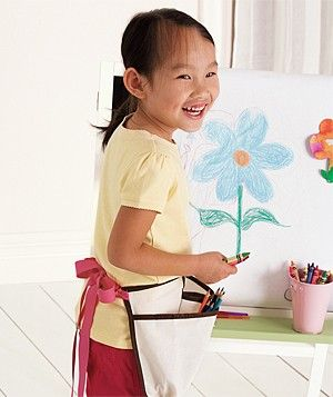 Cut off one pocketed strip of a hanging shoe holder, sew a ribbon onto each end, and tie it as you would a tool belt, around your little busybody's waist to stylishly store art supplies