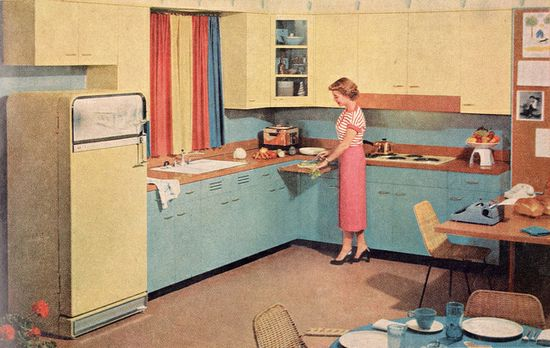 My grandma's kitchen had a pull out cutting board like this - it was really handy! #vintage #1940s #kitchen #home #decor #homemaker