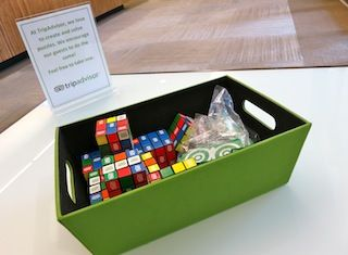 When you walk in the door at @Daniel Olson, you'll find a bucket of Rubik's Cubes and Legos just waiting to be picked up. TripAdvisor encourages its employees to always keep in a problem-solving and puzzle-tackling mindset, and the colorful toys are a fun, daily reminder of that mentality.