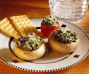 Spinach Stuffed Mushrooms: A simple stuffing and cheese topping are all you need to fill these savory mushroom appetizers.