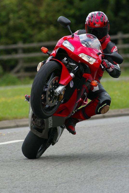 motor bike doing wheelie