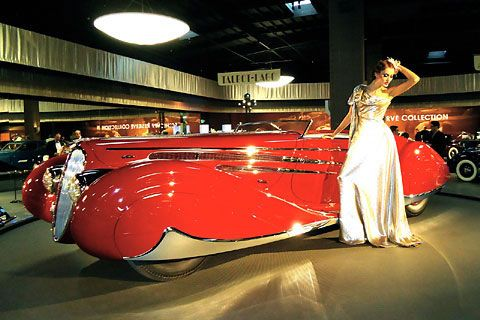 French Art Deco car.  Some things never change.  A slick car and a beautiful woman.