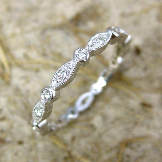 14k white gold round oval diamond wedding ring.