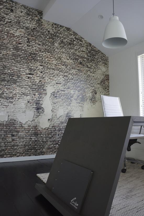 concrete desk + brick wallpaper + caravaggio   Luisa Interior Design office