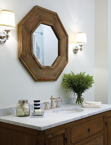 octagonal mirror above vanity w/sconces