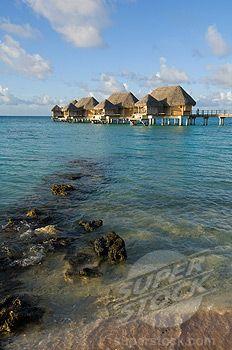 Stilt houses at a tourist resort on the beach, Tikehau Pearl Beach Resort, Tikehau, Tuamotu Archipelago, French Polynesia by © Sergio Pitamitz