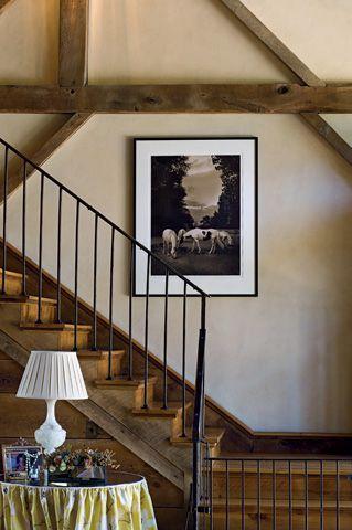 black iron stair railing in barn house