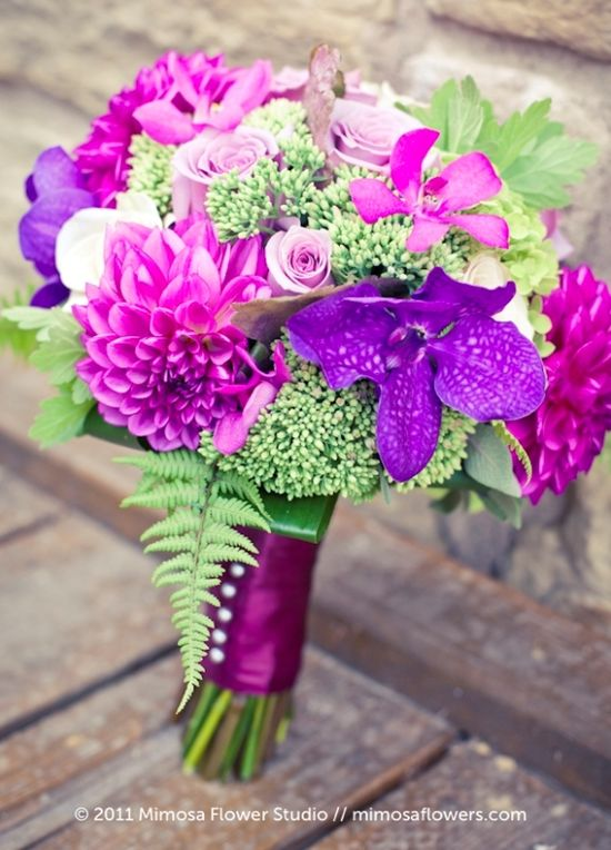Chic purple and pink wedding bouquet with fresh green accents