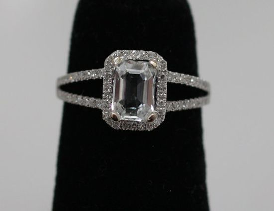 maybe? Emerald white sapphire in 14k white gold diamond setting