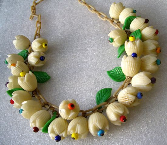 Vintage celluloid flowers and leaves unsigned Miriam Haskell necklace.