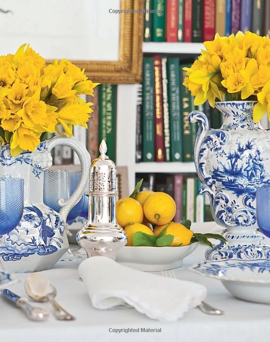 Blue and White china and bright yellow daffodils. Carolyne Roehm